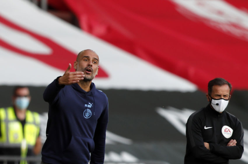 Manchester City's Spanish manager Pep Guardiola (L) gestures from the sidelines during the English Premier League football match between Southampton and Manchester City at St Mary's Stadium in Southampton, southern England on July 5, 2020. (Photo by Frank Augstein / POOL / AFP) / RESTRICTED TO EDITORIAL USE. No use with unauthorized audio, video, data, fixture lists, club/league logos or 'live' services. Online in-match use limited to 120 images. An additional 40 images may be used in extra time. No video emulation. Social media in-match use limited to 120 images. An additional 40 images may be used in extra time. No use in betting publications, games or single club/league/player publications. / (Photo by FRANK AUGSTEIN/POOL/AFP via Getty Images)