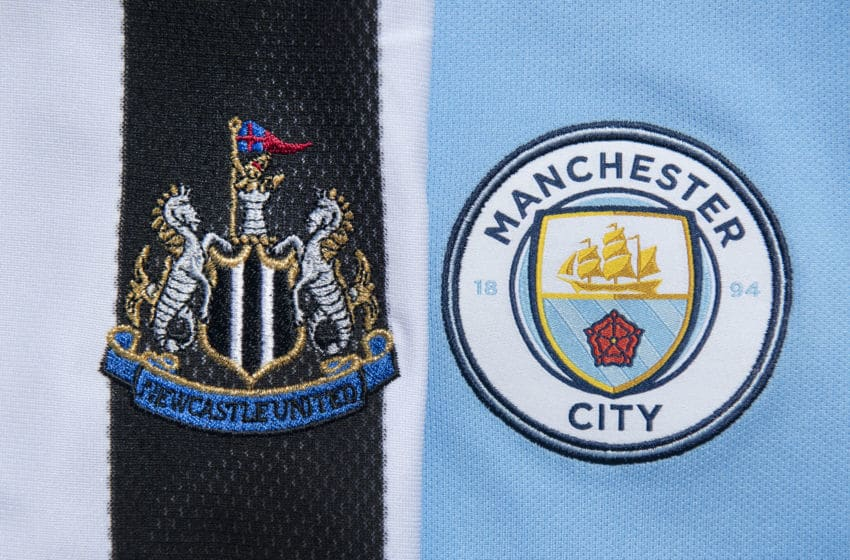 MANCHESTER, ENGLAND - MAY 14: The Newcastle United and Manchester City club crests on their first team home shirts on May 14, 2020 in Manchester, England. (Photo by Visionhaus)