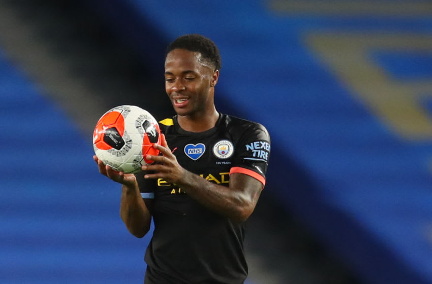 Manchester City's English midfielder Raheem Sterling collects the match ball after scoring a hat trick during the English Premier League football match between Brighton and Hove Albion and Manchester City at the American Express Community Stadium in Brighton, southern England on July 11, 2020. (Photo by Catherine Ivill / POOL / AFP) / RESTRICTED TO EDITORIAL USE. No use with unauthorized audio, video, data, fixture lists, club/league logos or 'live' services. Online in-match use limited to 120 images. An additional 40 images may be used in extra time. No video emulation. Social media in-match use limited to 120 images. An additional 40 images may be used in extra time. No use in betting publications, games or single club/league/player publications. / (Photo by CATHERINE IVILL/POOL/AFP via Getty Images)