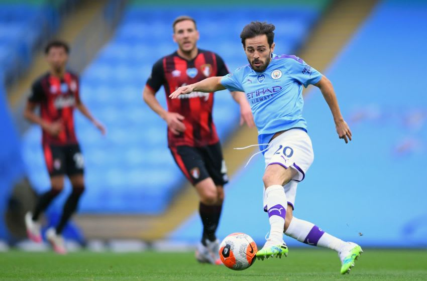 Manchester City's Portuguese midfielder Bernardo Silva controls the ball during the English Premier League football match between Manchester City and Bournemouth at the Etihad Stadium in Manchester, north-west England, on July 15, 2020. (Photo by LAURENCE GRIFFITHS / POOL / AFP) / RESTRICTED TO EDITORIAL USE. No use with unauthorized audio, video, data, fixture lists, club/league logos or 'live' services. Online in-match use limited to 120 images. An additional 40 images may be used in extra time. No video emulation. Social media in-match use limited to 120 images. An additional 40 images may be used in extra time. No use in betting publications, games or single club/league/player publications. / (Photo by LAURENCE GRIFFITHS/POOL/AFP via Getty Images)