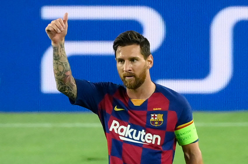 Barcelona's Argentine forward Lionel Messi celebrates after scoring a goal during the UEFA Champions League round of 16 second leg football match between FC Barcelona and Napoli at the Camp Nou stadium in Barcelona on August 8, 2020. (Photo by LLUIS GENE / AFP) (Photo by LLUIS GENE/AFP via Getty Images)