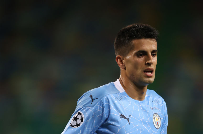 LISBON, PORTUGAL - AUGUST 15: Joao Cancelo of Manchester City during the UEFA Champions League Quarter Final match between Manchester City and Lyon at Estadio Jose Alvalade on August 15, 2020 in Lisbon, Portugal. (Photo by Matthew Ashton - AMA/Getty Images)