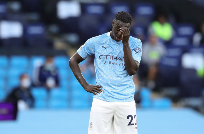 MANCHESTER, ENGLAND - SEPTEMBER 27: A dejected Benjamin Mendy of Manchester City during the Premier League match between Manchester City and Leicester City at Etihad Stadium on September 27, 2020 in Manchester, United Kingdom. Sporting stadiums around the UK remain under strict restrictions due to the Coronavirus Pandemic as Government social distancing laws prohibit fans inside venues resulting in games being played behind closed doors. (Photo by James Williamson - AMA/Getty Images)
