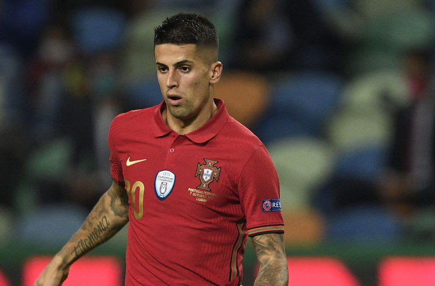 LISBON, PORTUGAL - OCTOBER 07: Joao Cancelo of Portugal controls the ball during the international friendly match between Portugal and Spain at Estadio Jose Alvalade on October 7, 2020 in Lisbon, Portugal. (Photo by Octavio Passos/Getty Images)