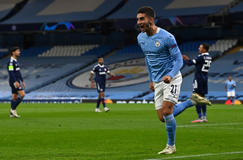 Manchester City's Spanish midfielder Ferran Torres celebrates scoring the opening goal during the UEFA Champions League football Group C match between Manchester City and Olympiakos at the Etihad Stadium in Manchester, north west England on November 3, 2020. (Photo by Paul ELLIS / AFP) (Photo by PAUL ELLIS/AFP via Getty Images)