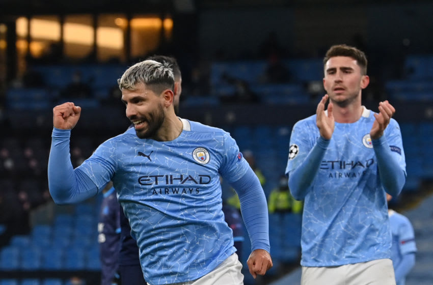 Manchester City's Argentinian striker Sergio Aguero (L) celebrates after he scores his team's second goal during the UEFA Champions League 1st round day 6 group C football match between Manchester City and Marseille at the Etihad Stadium in Manchester, north west England, on December 9, 2020. (Photo by Paul ELLIS / AFP) (Photo by PAUL ELLIS/AFP via Getty Images)