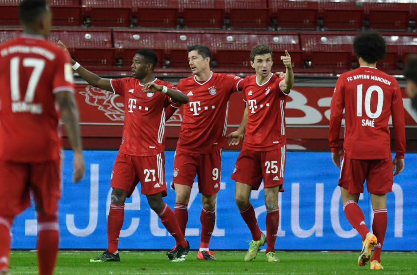(L-R) Bayern Munich's German defender Jerome Boateng, Bayern Munich's Austrian defender David Alaba, Bayern Munich's Polish forward Robert Lewandowski, Bayern Munich's German forward Thomas Mueller and Bayern Munich's German midfielder Leroy Sane celebrate after scoring the 1-1 during the German first division Bundesliga football match Bayer Leverkusen v FC Bayern Munich in Leverkusen, western Germany, on December 19, 2020. (Photo by Bernd Thissen / POOL / AFP) / DFL REGULATIONS PROHIBIT ANY USE OF PHOTOGRAPHS AS IMAGE SEQUENCES AND/OR QUASI-VIDEO (Photo by BERND THISSEN/POOL/AFP via Getty Images)