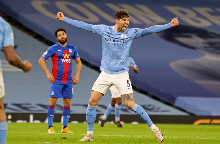 Manchester City's English defender John Stones celebrates after scoring their third goal during the English Premier League football match between Manchester City and Crystal Palace at the Etihad Stadium in Manchester, north west England, on January 17, 2021. (Photo by Clive Brunskill / POOL / AFP) / RESTRICTED TO EDITORIAL USE. No use with unauthorized audio, video, data, fixture lists, club/league logos or 'live' services. Online in-match use limited to 120 images. An additional 40 images may be used in extra time. No video emulation. Social media in-match use limited to 120 images. An additional 40 images may be used in extra time. No use in betting publications, games or single club/league/player publications. / (Photo by CLIVE BRUNSKILL/POOL/AFP via Getty Images)