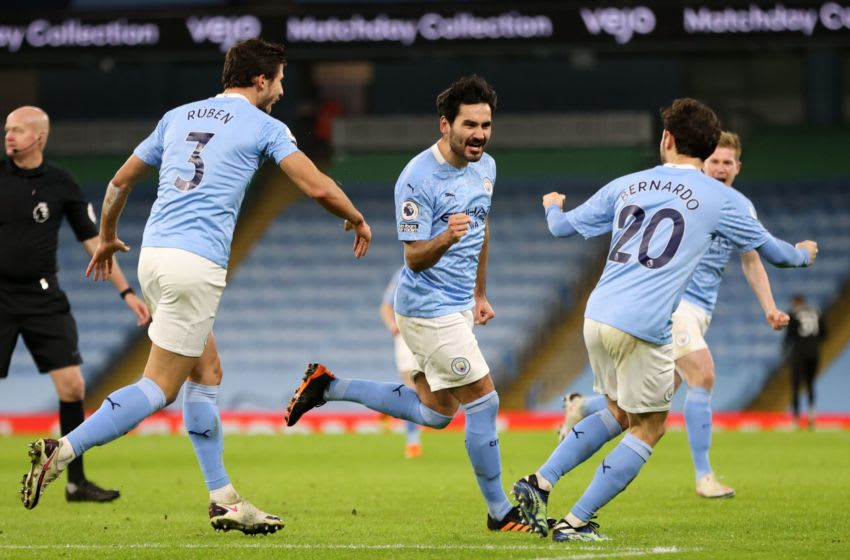 Manchester City's German midfielder Ilkay Gundogan (C) celebrates with teammates after scoring their second goal during the English Premier League football match between Manchester City and Crystal Palace at the Etihad Stadium in Manchester, north west England, on January 17, 2021. (Photo by Clive Brunskill / POOL / AFP) / RESTRICTED TO EDITORIAL USE. No use with unauthorized audio, video, data, fixture lists, club/league logos or 'live' services. Online in-match use limited to 120 images. An additional 40 images may be used in extra time. No video emulation. Social media in-match use limited to 120 images. An additional 40 images may be used in extra time. No use in betting publications, games or single club/league/player publications. / (Photo by CLIVE BRUNSKILL/POOL/AFP via Getty Images)
