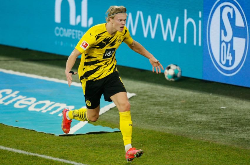 Dortmund's Norwegian forward Erling Braut Haaland celebrates scoring the 0-4 during the German first division Bundesliga football match FC Schalke 04 vs Borussia Dortmund in Gelsenkirchen, western Germany, on February 20, 2021. (Photo by Leon KUEGELER / POOL / AFP) / RESTRICTIONS: DFL REGULATIONS PROHIBIT ANY USE OF PHOTOGRAPHS AS IMAGE SEQUENCES AND/OR QUASI-VIDEO (Photo by LEON KUEGELER/POOL/AFP via Getty Images)