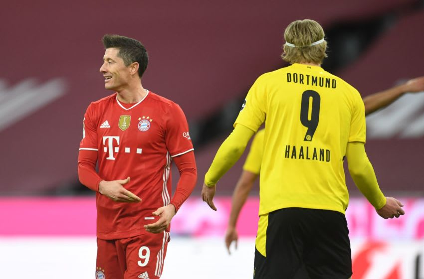 Bayern Munich's Polish forward Robert Lewandowski (L) and Dortmund's Norwegian forward Erling Braut Haaland gesture during the German first division Bundesliga football match between FC Bayern Munich and BVB Borussia Dortmund in Munich, southern Germany, on March 6, 2021. (Photo by ANDREAS GEBERT / POOL / AFP) / DFL REGULATIONS PROHIBIT ANY USE OF PHOTOGRAPHS AS IMAGE SEQUENCES AND/OR QUASI-VIDEO (Photo by ANDREAS GEBERT/POOL/AFP via Getty Images)