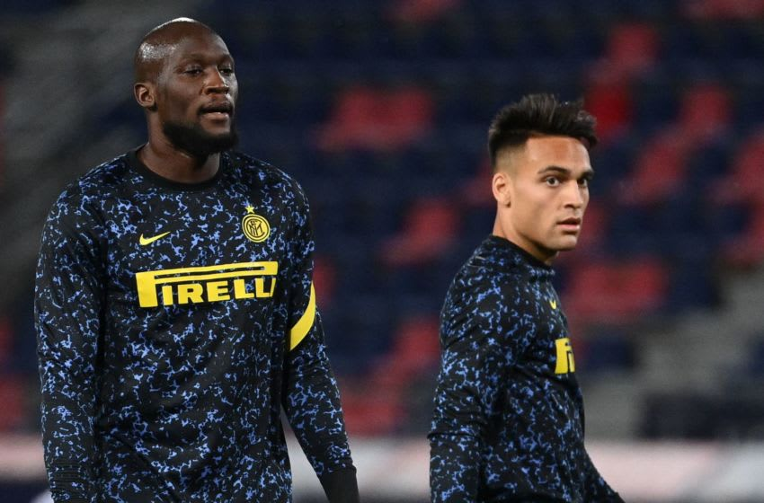 Inter Milan's Belgian forward Romelu Lukaku (L) and Inter Milan's Argentine forward Lautaro Martinez warm up prior to the Italian Serie A football match Bologna vs Inter Milan on April 03, 2021 at the Renato-Dall'Ara stadium in Bologna. (Photo by Vincenzo PINTO / AFP) (Photo by VINCENZO PINTO/AFP via Getty Images)