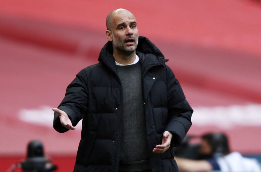 Manchester City's Spanish manager Pep Guardiola gestures on the touchline during the English FA Cup semi-final football match between Chelsea and Manchester City at Wembley Stadium in north west London on April 17, 2021. - - NOT FOR MARKETING OR ADVERTISING USE / RESTRICTED TO EDITORIAL USE (Photo by Ian Walton / POOL / AFP) / NOT FOR MARKETING OR ADVERTISING USE / RESTRICTED TO EDITORIAL USE (Photo by IAN WALTON/POOL/AFP via Getty Images)