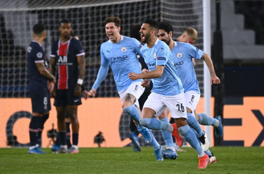 Manchester City's Algerian midfielder Riyad Mahrez celebrates after scoring a goal during the UEFA Champions League first leg semi-final football match between Paris Saint-Germain (PSG) and Manchester City at the Parc des Princes stadium in Paris on April 28, 2021. (Photo by Anne-Christine POUJOULAT / AFP) (Photo by ANNE-CHRISTINE POUJOULAT/AFP via Getty Images)