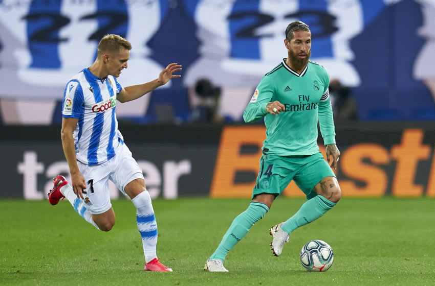SAN SEBASTIAN, SPAIN - JUNE 21: Martin Odegaard of Real Sociedad competes for the ball with Sergio Ramos of Real Madrid during the La Liga match between Real Sociedad and Real Madrid CF at Estadio Anoeta on June 21, 2020 in San Sebastian, Spain. (Photo by Pedro Salado/Quality Sport Images/Getty Images)