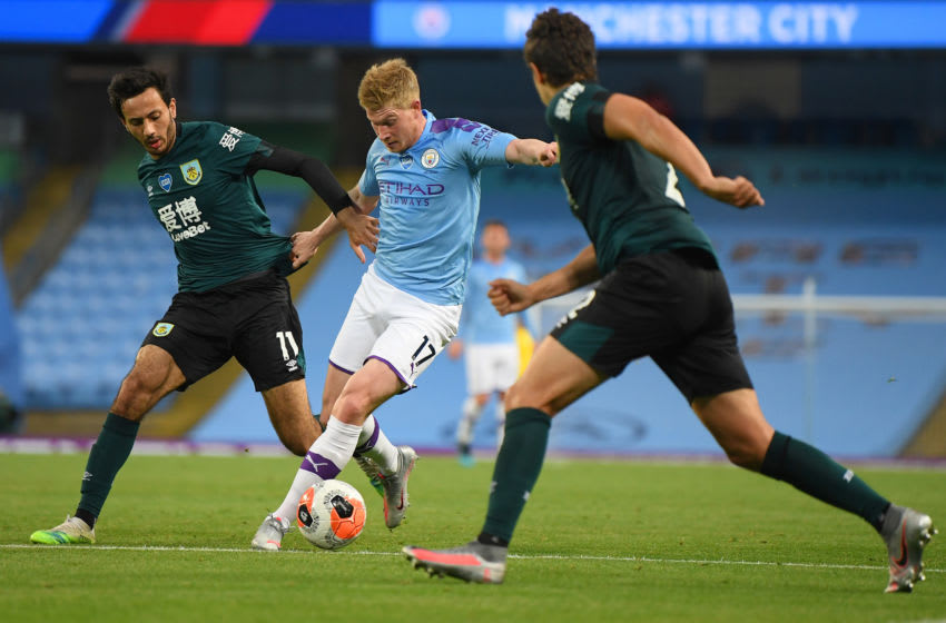 MANCHESTER, ENGLAND - JUNE 22: Kevin De Bruyne of Manchester City in action as Dwight McNeil of Burnley looks on during the Premier League match between Manchester City and Burnley FC at Etihad Stadium on June 22, 2020 in Manchester, England. Football stadiums around Europe remain empty due to the Coronavirus Pandemic as Government social distancing laws prohibit fans inside venus resulting in all fixtures being played behind closed doors. (Photo by Michael Regan/Getty Images)