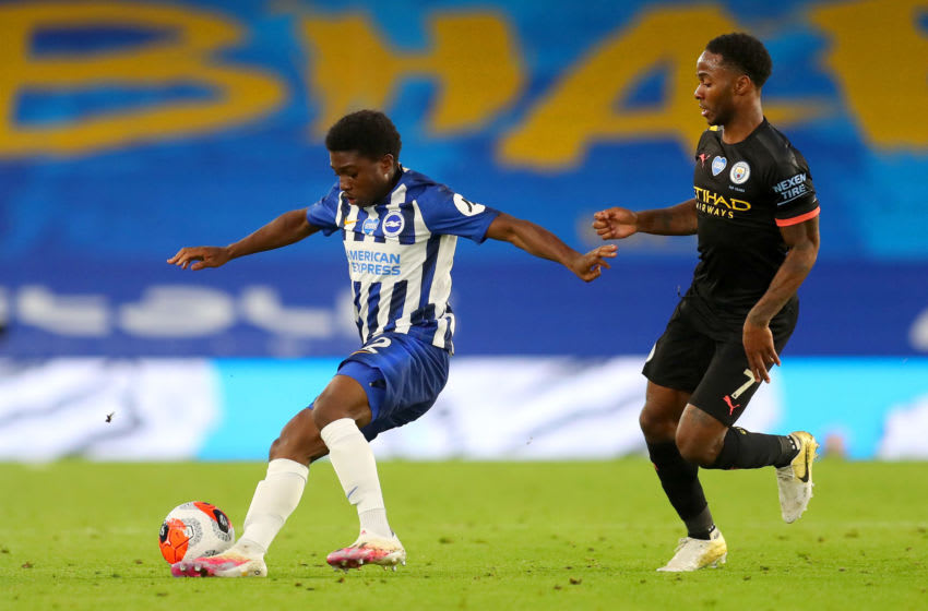 BRIGHTON, ENGLAND - JULY 11: Raheem Sterling of Manchester City puts pressure on Tariq Lamptey of Brighton and Hove Albion during the Premier League match between Brighton & Hove Albion and Manchester City at American Express Community Stadium on July 11, 2020 in Brighton, England. Football Stadiums around Europe remain empty due to the Coronavirus Pandemic as Government social distancing laws prohibit fans inside venues resulting in all fixtures being played behind closed doors. (Photo by Catherine Ivill/Getty Images)