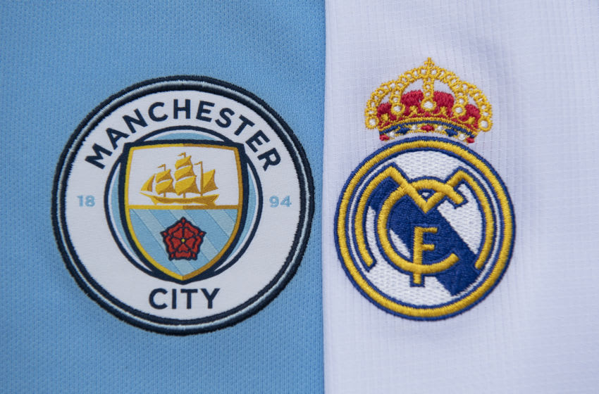 MANCHESTER, ENGLAND - JULY 19: The Manchester City and Real Madrid club crests on the first team home shirts on July 19, 2020 in Manchester, United Kingdom. (Photo by Visionhaus)