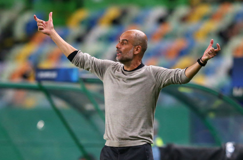 LISBON, PORTUGAL - AUGUST 15: Pep Guardiola the manager of Manchester City reacts during the UEFA Champions League Quarter Final match between Manchester City and Lyon at Estadio Jose Alvalade on August 15, 2020 in Lisbon, Portugal. (Photo by Alex Livesey - Danehouse/Getty Images)