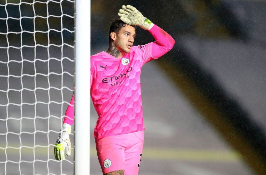 LEEDS, ENGLAND - OCTOBER 03: Ederson of Manchester City reacts during the Premier League match between Leeds United and Manchester City at Elland Road on October 03, 2020 in Leeds, England. Sporting stadiums around the UK remain under strict restrictions due to the Coronavirus Pandemic as Government social distancing laws prohibit fans inside venues resulting in games being played behind closed doors. (Photo by Catherine Ivill/Getty Images)