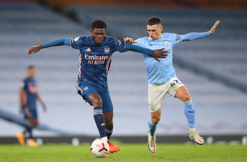 MANCHESTER, ENGLAND - OCTOBER 17: Thomas Partey of Arsenal battles for possession with Phil Foden of Manchester City during the Premier League match between Manchester City and Arsenal at Etihad Stadium on October 17, 2020 in Manchester, England. Sporting stadiums around the UK remain under strict restrictions due to the Coronavirus Pandemic as Government social distancing laws prohibit fans inside venues resulting in games being played behind closed doors. (Photo by Alex Livesey/Getty Images)