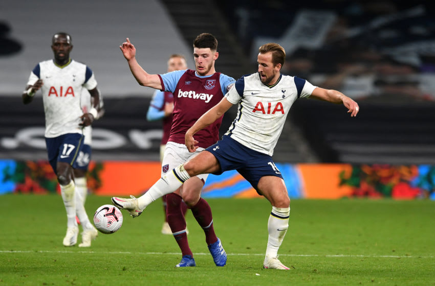 LONDON, ENGLAND - OCTOBER 18: Harry Kane of Tottenham Hotspur is challenged by Declan Rice of West Ham United during the Premier League match between Tottenham Hotspur and West Ham United at Tottenham Hotspur Stadium on October 18, 2020 in London, England. Sporting stadiums around the UK remain under strict restrictions due to the Coronavirus Pandemic as Government social distancing laws prohibit fans inside venues resulting in games being played behind closed doors.( Photo by Neil Hall - Pool/Getty Images)