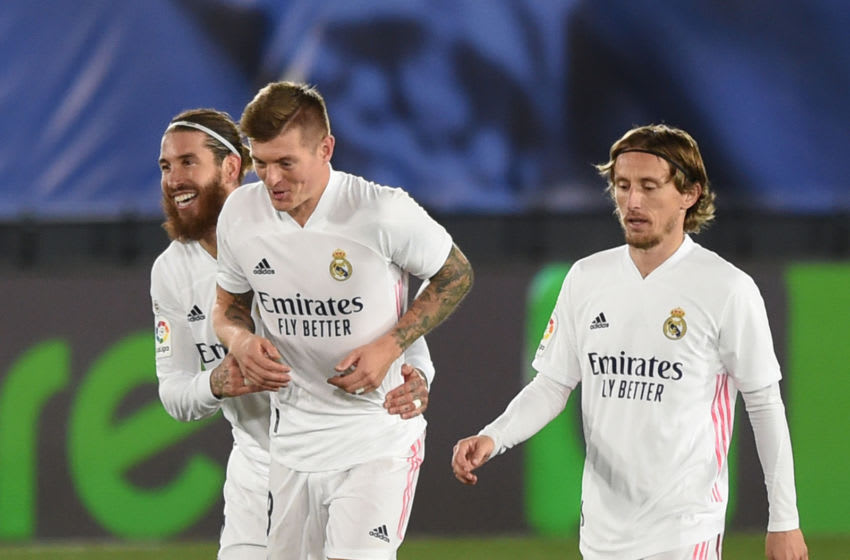 MADRID, SPAIN - DECEMBER 15: Toni Kroos of Real Madrid celebrates with Sergio Ramos and Luka Modric after scoring his team's opening goal during the La Liga Santander match between Real Madrid and Athletic Club at Estadio Alfredo Di Stefano on December 15, 2020 in Madrid, Spain. Sporting stadiums around Spain remain under strict restrictions due to the Coronavirus Pandemic as Government social distancing laws prohibit fans inside venues resulting in games being played behind closed doors. (Photo by Denis Doyle/Getty Images)