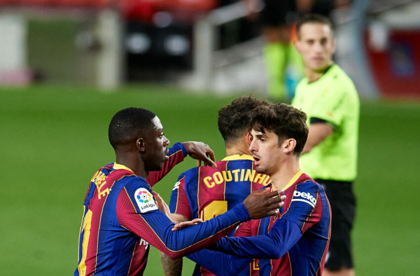 BARCELONA, SPAIN - DECEMBER 29: Ousmane Dembele of FC Barcelona celebrates with his teammate Francisco Trincao after scoring his team's first goal during the La Liga Santander match between FC Barcelona and SD Eibar at Camp Nou on December 29, 2020 in Barcelona, Spain. Sporting stadiums around Spain remain under strict restrictions due to the Coronavirus Pandemic as Government social distancing laws prohibit fans inside venues resulting in games being played behind closed doors. (Photo by Alex Caparros/Getty Images)