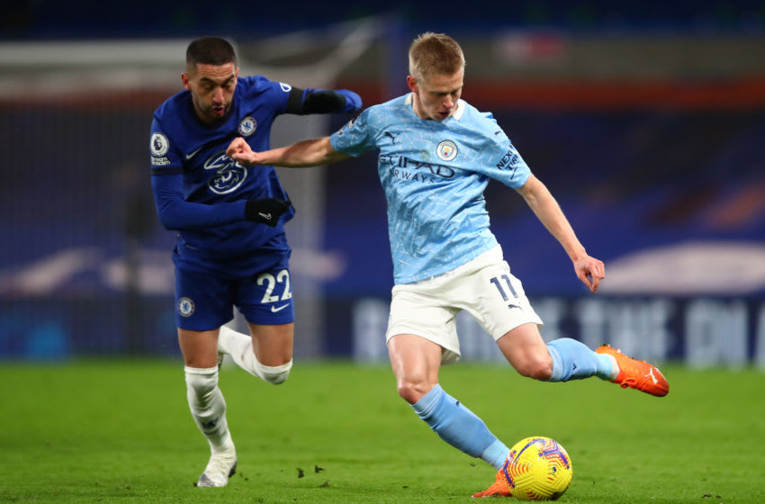 LONDON, ENGLAND - JANUARY 03: Oleksandr Zinchenko of Manchester City is challenged by Hakim Ziyech of Chelsea during the Premier League match between Chelsea and Manchester City at Stamford Bridge on January 03, 2021 in London, England. The match will be played without fans, behind closed doors as a Covid-19 precaution. (Photo by Marc Atkins/Getty Images)