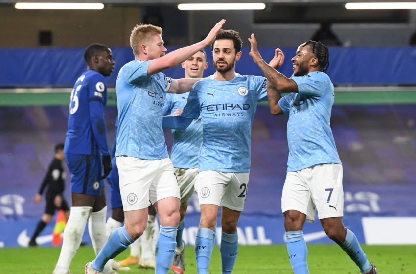 LONDON, ENGLAND - JANUARY 03: Kevin De Bruyne of Manchester City (L) celebrates after scoring their sides third goal with Raheem Sterling of Manchester City (R) and Bernardo Silva of Manchester City (C) during the Premier League match between Chelsea and Manchester City at Stamford Bridge on January 03, 2021 in London, England. The match will be played without fans, behind closed doors as a Covid-19 precaution. (Photo by Andy Rain - Pool/Getty Images)