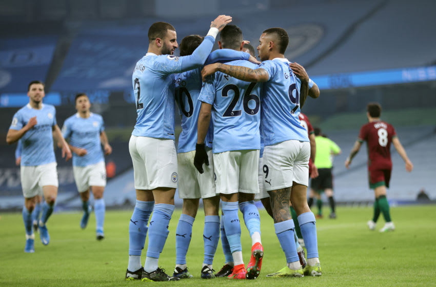 MANCHESTER, ENGLAND - MARCH 02: Kyle Walker, Bernardo Silva, Riyad Mahrez, Gabriel Jesus and Raheem Sterling of Manchester City celebrate their first goal, which was an own goal scored by Leander Dendoncker of Wolverhampton Wanderers (not pictured) during the Premier League match between Manchester City and Wolverhampton Wanderers at Etihad Stadium on March 02, 2021 in Manchester, England. Sporting stadiums around the UK remain under strict restrictions due to the Coronavirus Pandemic as Government social distancing laws prohibit fans inside venues resulting in games being played behind closed doors. (Photo by Clive Brunskill/Getty Images)