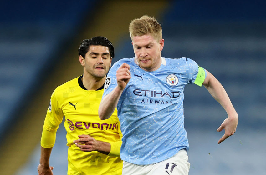 MANCHESTER, ENGLAND - APRIL 06: Kevin De Bruyne of Manchester Cityruns with the ball during the UEFA Champions League Quarter Final match between Manchester City and Borussia Dortmund at Etihad Stadium on April 06, 2021 in Manchester, England. Sporting stadiums around the UK remain under strict restrictions due to the Coronavirus Pandemic as Government social distancing laws prohibit fans inside venues resulting in games being played behind closed doors. (Photo by Clive Brunskill/Getty Images)
