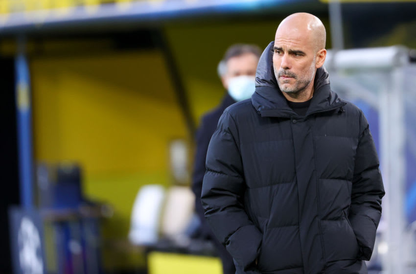 DORTMUND, GERMANY - APRIL 14: Coach Pep Guardiola of Manchester City during the UEFA Champions League Quarter Final 1: Leg Two match between Borussia Dortmund and Manchester City at Signal Iduna Park on April 14, 2021 in Dortmund, Germany (Photo by Joachim Bywaletz/BSR Agency/Getty Images)