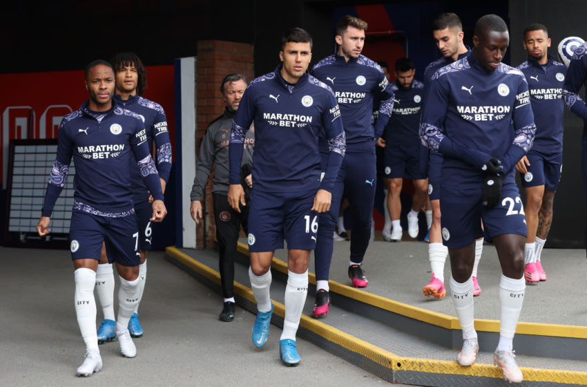 LONDON, ENGLAND - MAY 01: Raheem Sterling, Rodrigo and Benjamin Mendy of Manchester City walk out for the warm up prior to the Premier League match between Crystal Palace and Manchester City at Selhurst Park on May 01, 2021 in London, England. Sporting stadiums around the UK remain under strict restrictions due to the Coronavirus Pandemic as Government social distancing laws prohibit fans inside venues resulting in games being played behind closed doors. (Photo by Clive Rose/Getty Images)