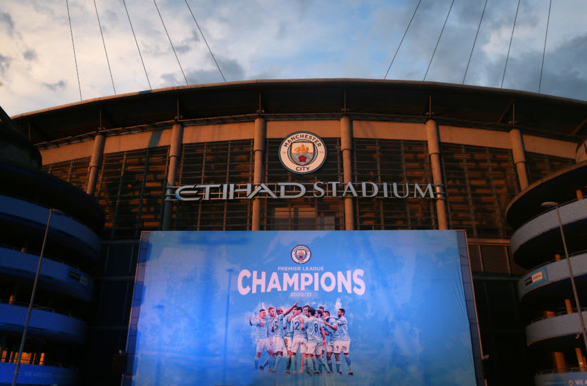 MANCHESTER, ENGLAND - MAY 11: A champions banner is seen outside Etihad Stadium as Manchester City fans celebrate winning the Premier League title on May 11, 2021 in Manchester, England. Manchester City Football club claims the Premier League title as nearest rival Manchester United lost to Leicester today 1-2. Football fans are currently unable to attend matches due to coronavirus restrictions. (Photo by Alex Livesey - Danehouse/Getty Images)