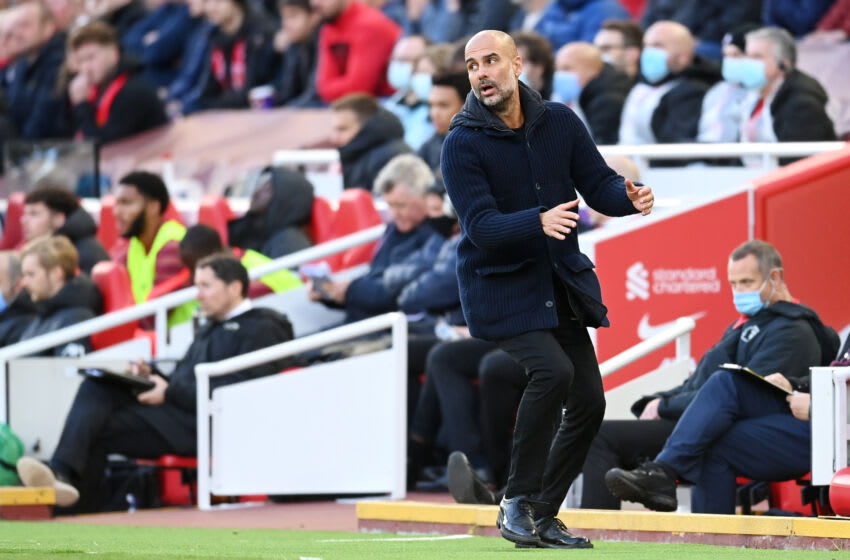 LIVERPOOL, ENGLAND - OCTOBER 03: Pep Guardiola, Manager of Manchester City reacts during the Premier League match between Liverpool and Manchester City at Anfield on October 03, 2021 in Liverpool, England. (Photo by Michael Regan/Getty Images)