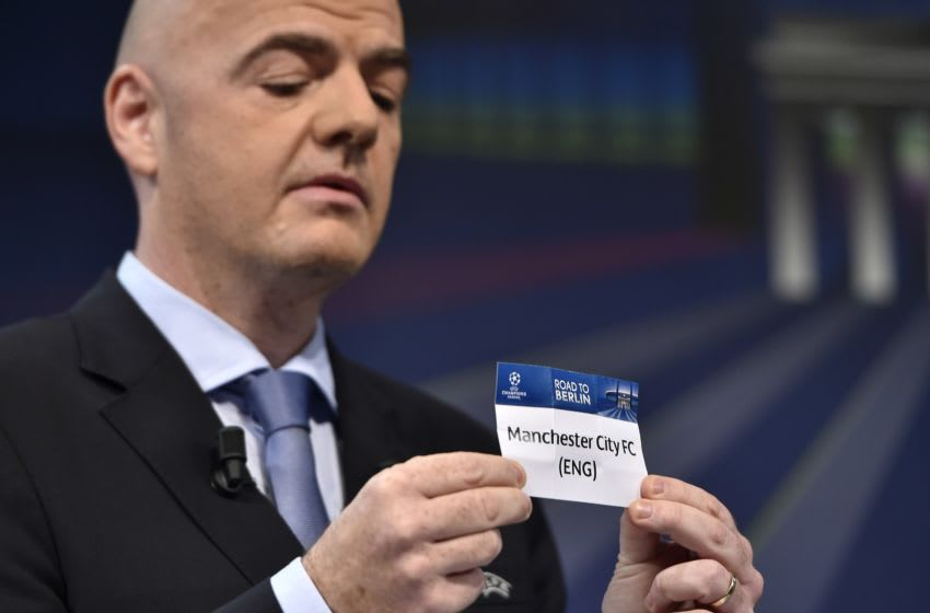 UEFA General Secretary Gianni Infantino presents the name Manchester City FC during the draw for the UEFA Champions League round of 16 on December 15, 2014 at the UEFA headquarters in Nyon. AFP PHOTO / FABRICE COFFRINI (Photo credit should read FABRICE COFFRINI/AFP via Getty Images)