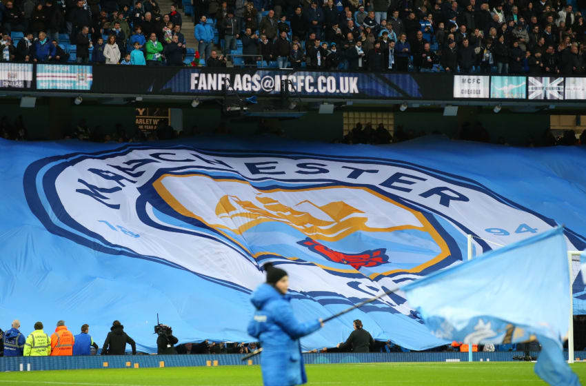 MANCHESTER, ENGLAND - DECEMBER 26: A new club badge design is displayed by fans during the Barclays Premier League match between Manchester City and Sunderland at the Etihad Stadium on December 26, 2015 in Manchester, England. (Photo by Alex Livesey/Getty Images)