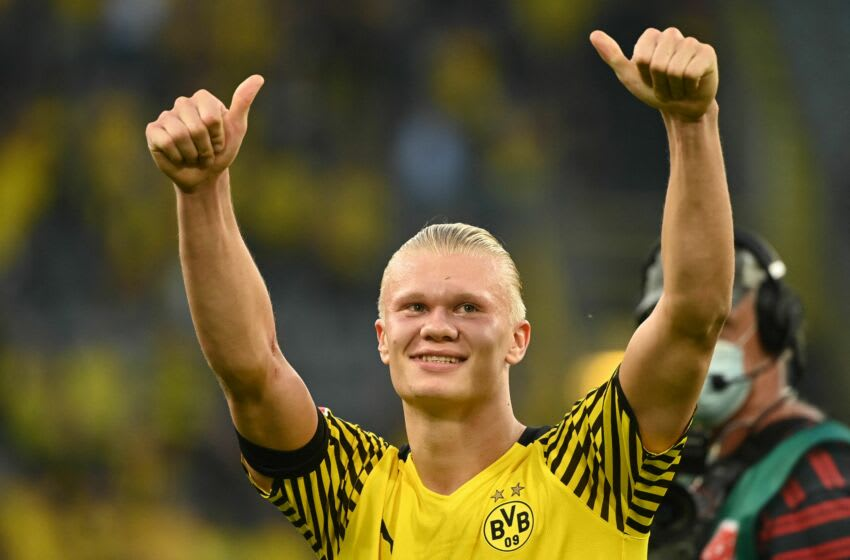 Dortmund's Norwegian forward Erling Braut Haaland acknowledges the fans after the German first division Bundesliga football match between Borussia Dortmund and Eintracht Frankfurt in Dortmund, western Germany, on August 14, 2021. - DFL REGULATIONS PROHIBIT ANY USE OF PHOTOGRAPHS AS IMAGE SEQUENCES AND/OR QUASI-VIDEO (Photo by Ina Fassbender / AFP) / DFL REGULATIONS PROHIBIT ANY USE OF PHOTOGRAPHS AS IMAGE SEQUENCES AND/OR QUASI-VIDEO (Photo by INA FASSBENDER/AFP via Getty Images)