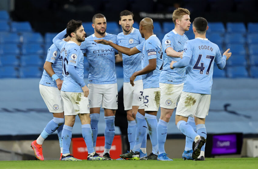 MANCHESTER, ENGLAND - MARCH 10: Riyad Mahrez (Hidden) of Manchester City celebrates with team mates (L - R) Bernardo Silva, Kyle Walker, Ruben Dias, Fernandinho, Kevin De Bruyne and Phil Foden after scoring their side's second goal during the Premier League match between Manchester City and Southampton at Etihad Stadium on March 10, 2021 in Manchester, England. Sporting stadiums around the UK remain under strict restrictions due to the Coronavirus Pandemic as Government social distancing laws prohibit fans inside venues resulting in games being played behind closed doors. (Photo by Clive Brunskill/Getty Images)