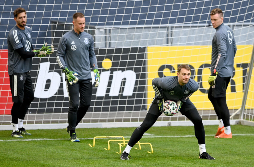 DUESSELDORF, GERMANY - MARCH 23: (L-R) Kevin Trapp, Marc-André ter Stegen, Manuel Neuer and Bernd Leno look on uring a training session at Esprit-Arena on March 23, 2021 in Duesseldorf, Germany. (Photo by Lukas Schulze/Getty Images)