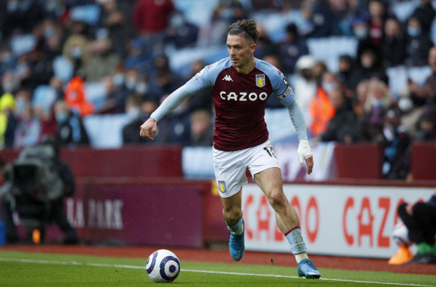 BIRMINGHAM, ENGLAND - MAY 23: Jack Grealish of Aston Villa runs with the ball during the Premier League match between Aston Villa and Chelsea at Villa Park on May 23, 2021 in Birmingham, England. A limited number of fans will be allowed into Premier League stadiums as Coronavirus restrictions begin to ease in the UK following the COVID-19 pandemic. (Photo by Malcolm Couzens/Getty Images)