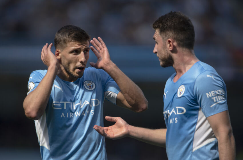 MANCHESTER, ENGLAND - AUGUST 28: Rúben Dias and Aymeric Laporte of Manchester City during the Premier League match between Manchester City and Arsenal at Etihad Stadium on August 28, 2021 in Manchester, England. (Photo by Visionhaus/Getty Images)