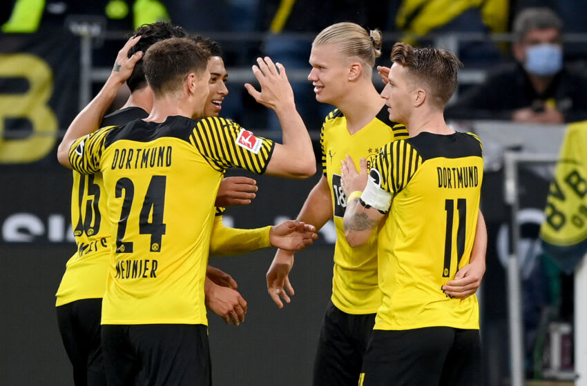DORTMUND, GERMANY - SEPTEMBER 19: Erling Haaland (2ndR) of Dortmund celebrates his 4-2 goal with teammates Marco Reus (R), Mats Hummels (L), Thomas Meunier (2ndL) and Mahmoud Dahoud during the Bundesliga match between Borussia Dortmund and 1. FC Union Berlin at Signal Iduna Park on September 19, 2021 in Dortmund, Germany. (Photo by Matthias Hangst/Getty Images)