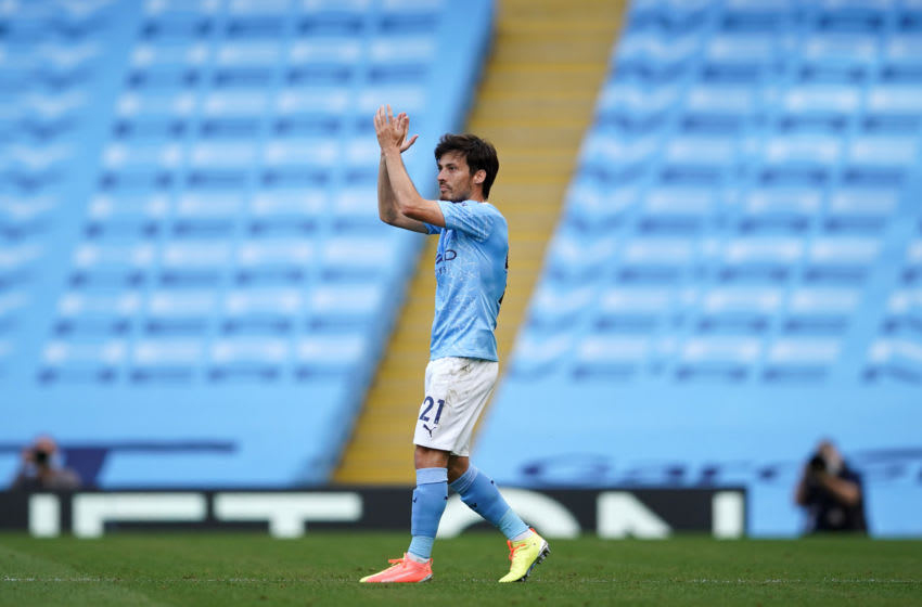 MANCHESTER, ENGLAND - JULY 26: David Silva of Manchester City applauds as he is substituted during the Premier League match between Manchester City and Norwich City at Etihad Stadium on July 26, 2020 in Manchester, England.Football Stadiums around Europe remain empty due to the Coronavirus Pandemic as Government social distancing laws prohibit fans inside venues resulting in all fixtures being played behind closed doors. (Photo by Dave Thompson/Pool via Getty Images)