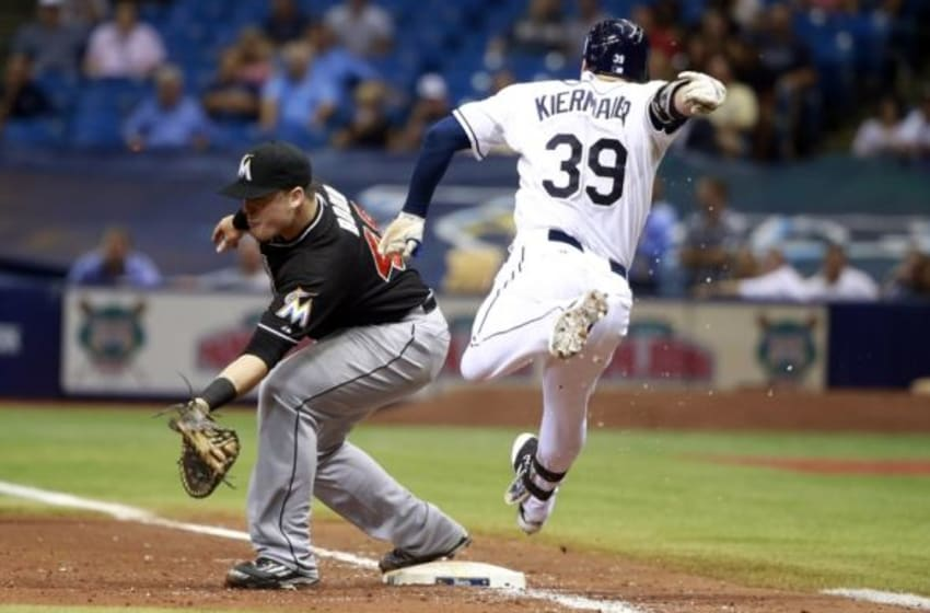 Sep 29, 2015; St. Petersburg, FL, USA; Miami Marlins first baseman Justin Bour (48) focus out Tampa Bay Rays center fielder Kevin Kiermaier (39) during the sixth inning at Tropicana Field. Mandatory Credit: Kim Klement-USA TODAY Sports