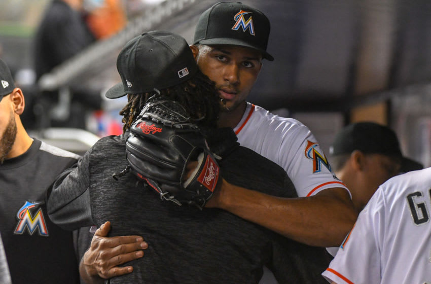 MIAMI, FL - SEPTEMBER 5: Sandy Alcantara #22 of the Miami Marlins hugs Jose Urena #62 after being pulled in the seventh inning for a relief pitcher against the Philadelphia Phillies at Marlins Park on September 5, 2018 in Miami, Florida. (Photo by Eric Espada/Getty Images)