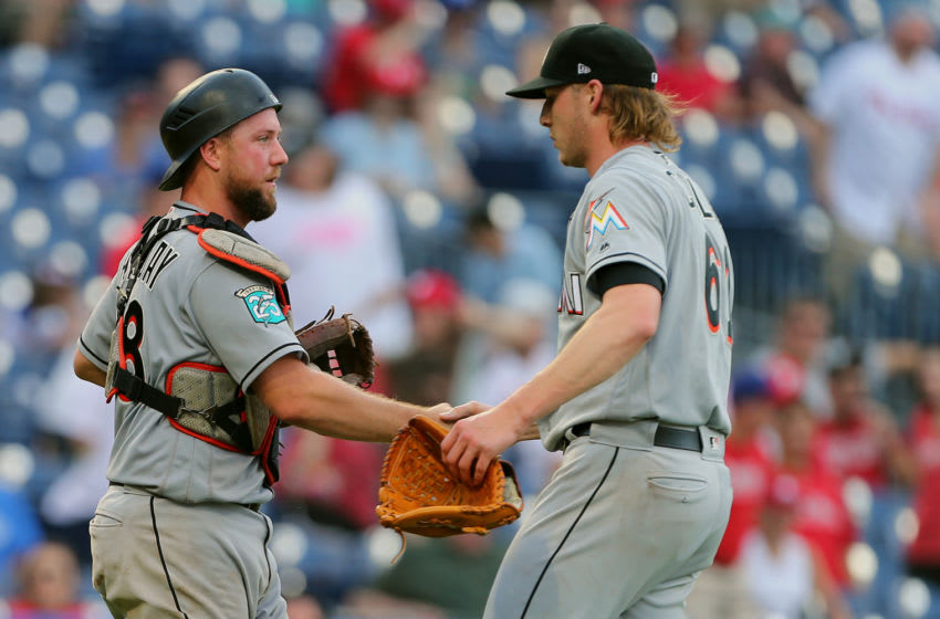 PHILADELPHIA, PA - SEPTEMBER 16: Catcher Bryan Holaday #28 of the Miami Marlins congratulates pitcher Adam Conley #61 after defeating the Philadelphia Phillies 6-4 in a game at Citizens Bank Park on September 16, 2018 in Philadelphia, Pennsylvania. (Photo by Rich Schultz/Getty Images)