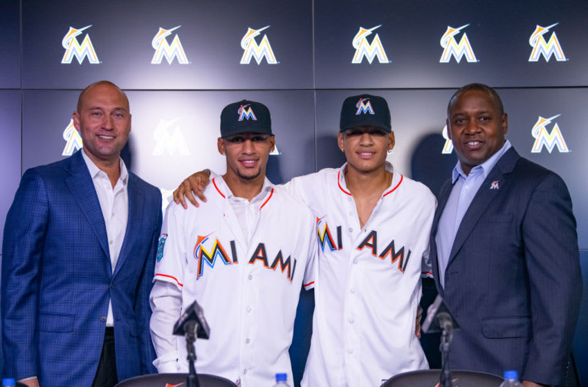 MIAMI, FL - OCTOBER 22: (L-R) Chief Executive Officer Derek Jeter of the Miami Marlins, Cuban baseball players and brothers Victor Victor Mesa, Victor Mesa Jr., and President of Baseball Operations Michael Hill meet with members of the media to announce the signing of the Mesa brothers at Marlins Park on October 22, 2018 in Miami, Florida. (Photo by Mark Brown/Getty Images)