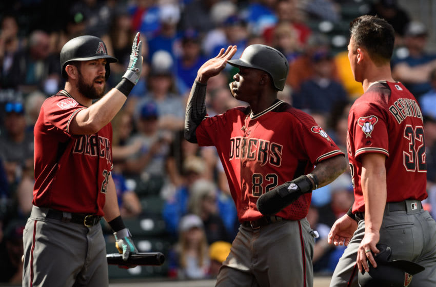 MESA, ARIZONA - FEBRUARY 26: Jazz Chisholm #82 of the Arizona Diamondbacks is congratulated by Steven Souza Jr. #28 after scoring against the Chicago Cubs during the spring training game at Sloan Park on February 26, 2019 in Mesa, Arizona. (Photo by Jennifer Stewart/Getty Images)